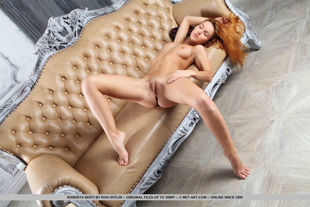 Hot Redhead Girl posing on the sofa